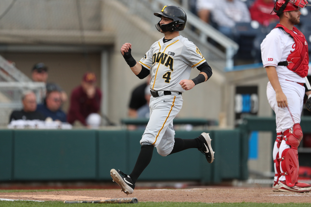 Iowa Hawkeyes infielder Mitchell Boe (4) scores against the Indiana Hoosiers in the first round of the Big Ten Baseball Tournament Wednesday, May 22, 2019 at TD Ameritrade Park in Omaha, Neb. (Brian Ray/hawkeyesports.com)
