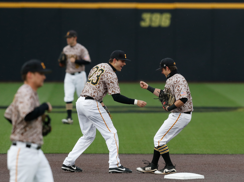 Iowa Hawkeyes infielder Mitchell Boe (4) and infielder Kyle Crowl (23) during a double header against the Indiana Hoosiers Friday, March 23, 2018 at Duane Banks Field. (Brian Ray/hawkeyesports.com)