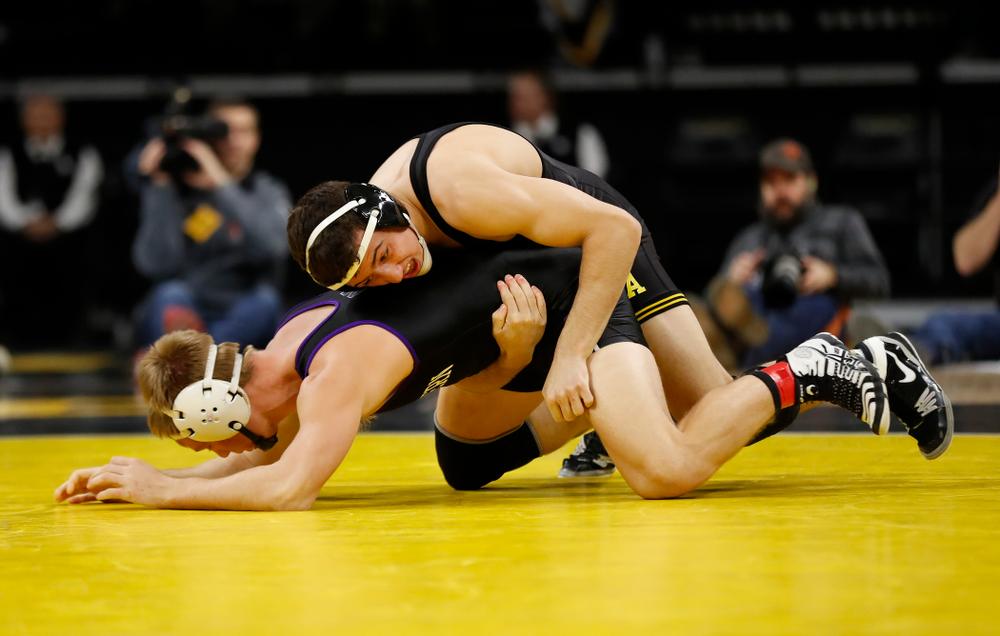 Iowa's Michael Kemerer wrestles Northwestern's Shane Oster at 157 pounds