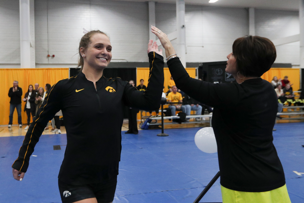 Ashley Smith high fives assistant coach Jennifer Green before the Iowa women's gymnastics Black and Gold Intraquad Meet on Saturday, December 7, 2019 at the UI Field House. (Lily Smith/hawkeyesports.com)