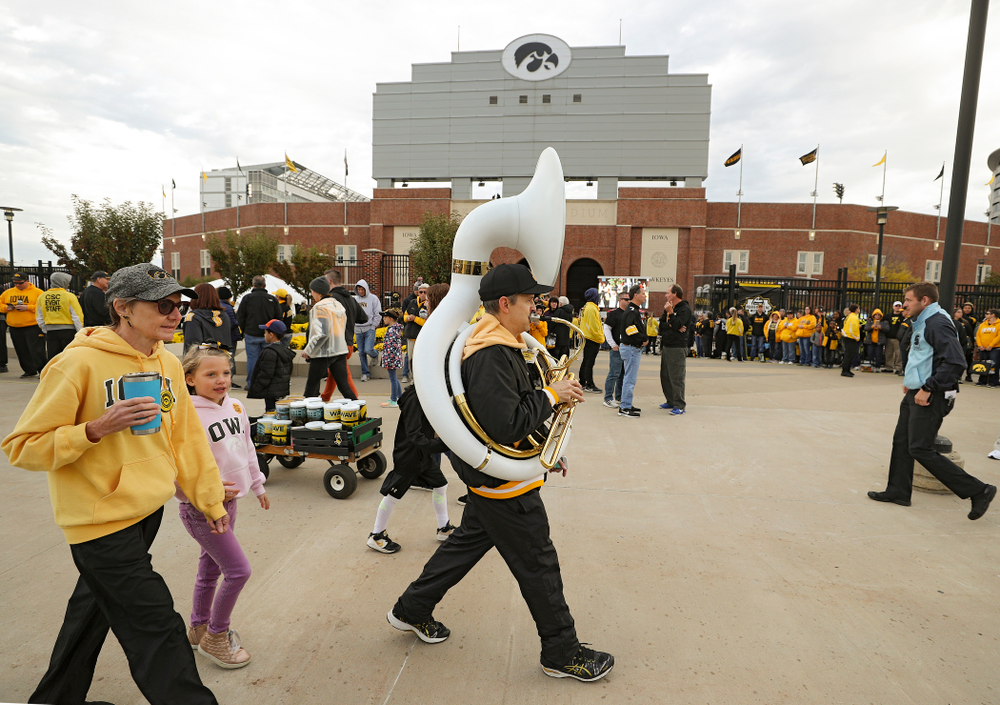 A man plays a sousaphone as he walks along Melrose Avenue before the game at Kinnick Stadium in Iowa City on Saturday, Oct 19, 2019. (Stephen Mally/hawkeyesports.com)