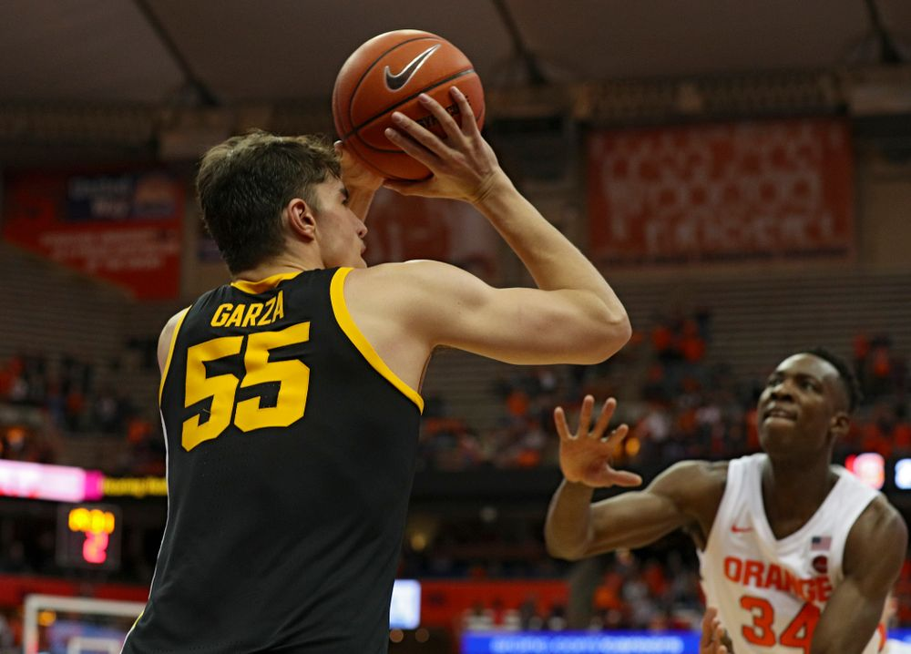 Iowa Hawkeyes center Luka Garza (55) makes a 3-pointer during the second half of their ACC/Big Ten Challenge game at the Carrier Dome in Syracuse, N.Y. on Tuesday, Dec 3, 2019. (Stephen Mally/hawkeyesports.com)