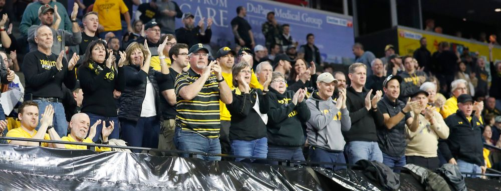 Hawkeye fans cheer a fall by Abe Assad