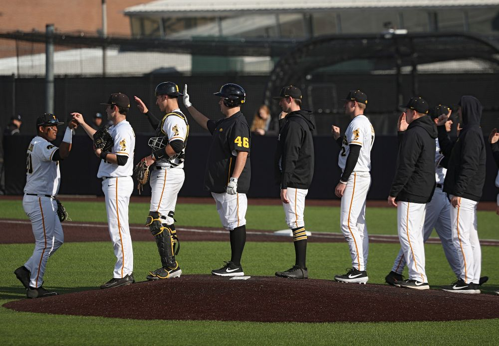 The Hawkeyes celebrate after winning their college baseball game at Duane Banks Field in Iowa City on Wednesday, March 11, 2020. (Stephen Mally/hawkeyesports.com)