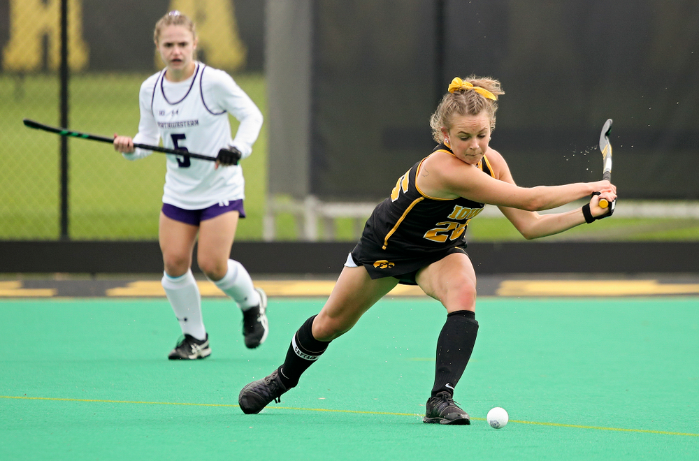 Iowa's Maddy Murphy (26) lines up a shot during the first quarter of their game at Grant Field in Iowa City on Saturday, Oct 26, 2019. (Stephen Mally/hawkeyesports.com)
