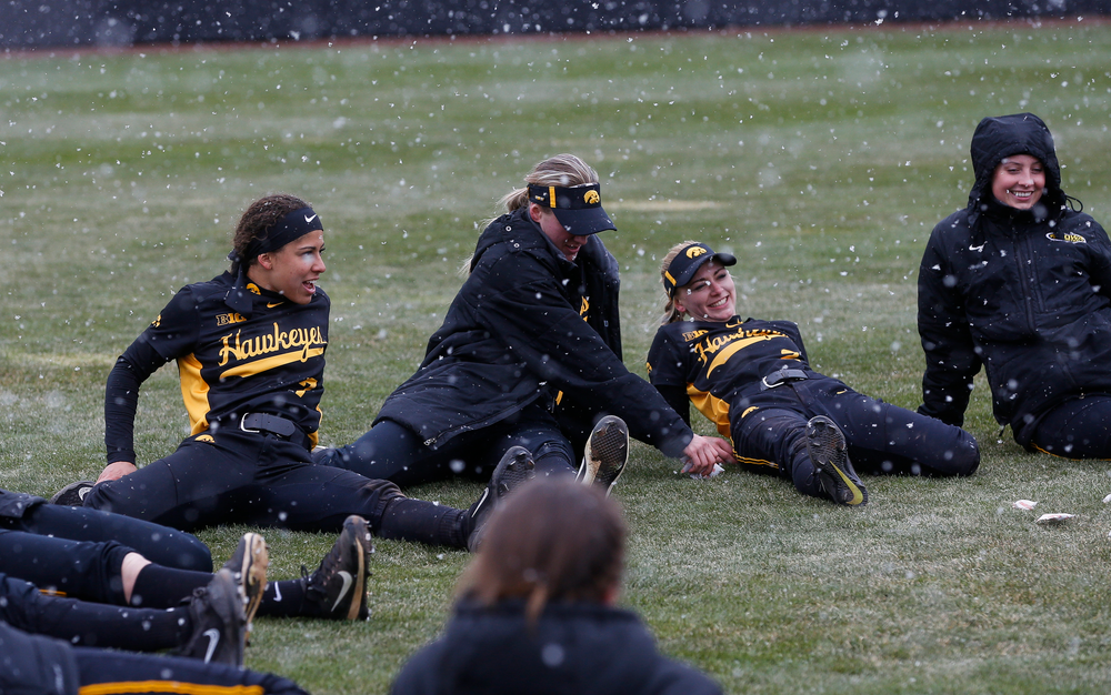 Iowa Hawkeyes infielder Lea Thompson (7), Iowa Hawkeyes outfielder Allie Wood (17), Iowa Hawkeyes infielder Aralee Bogar (2)