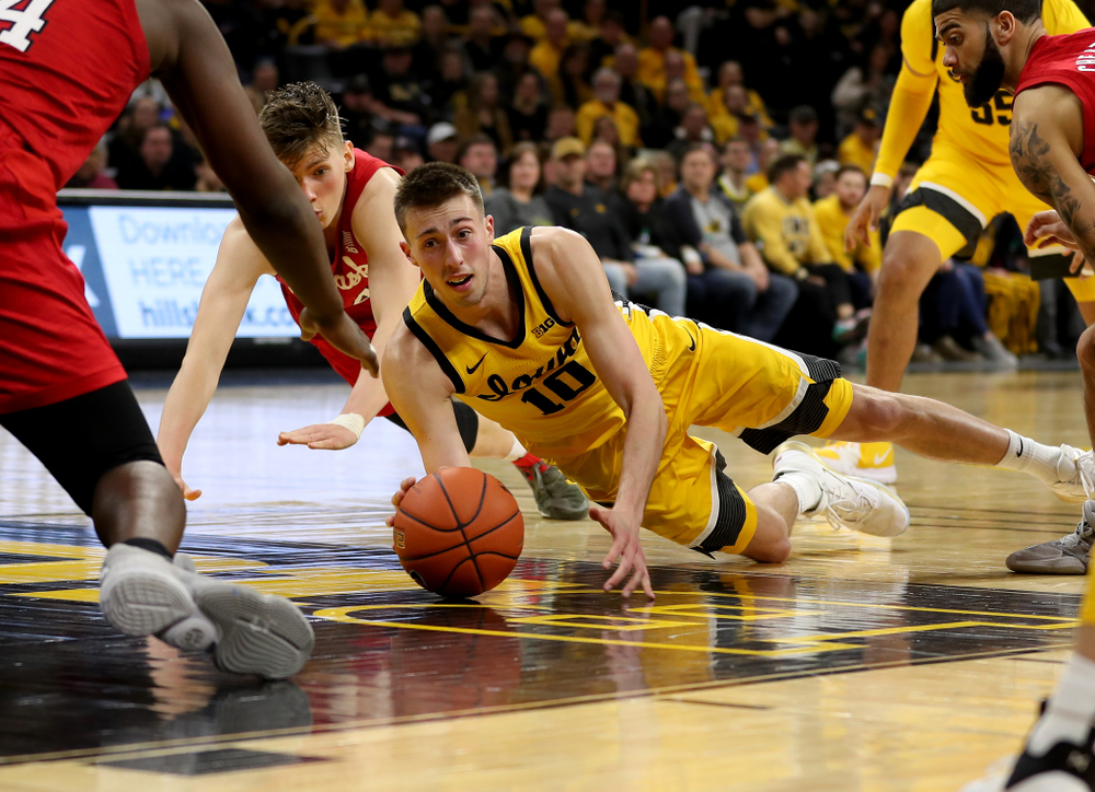 Iowa Hawkeyes guard Joe Wieskamp (10) dives for a loose ball against the Nebraska Cornhuskers Saturday, February 8, 2020 at Carver-Hawkeye Arena. (Brian Ray/hawkeyesports.com)