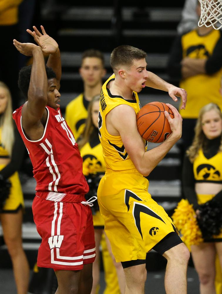Iowa Hawkeyes guard Joe Wieskamp (10) grabs the rebound against Wisconsin on November 30, 2018 at Carver-Hawkeye Arena. (Tork Mason/hawkeyesports.com)