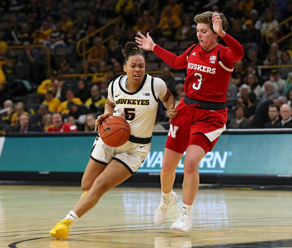 Iowa Hawkeyes guard Alexis Sevillian (5) drives with the ball during the fourth quarter of the game at Carver-Hawkeye Arena in Iowa City on Thursday, February 6, 2020. (Stephen Mally/hawkeyesports.com)