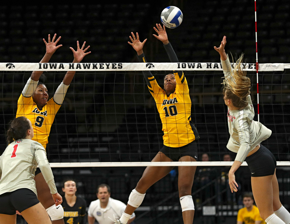 Iowa's Griere Hughes (10) blocks a shot as Amiya Jones (9) looks on during the first set of their match at Carver-Hawkeye Arena in Iowa City on Friday, Nov 29, 2019. (Stephen Mally/hawkeyesports.com)