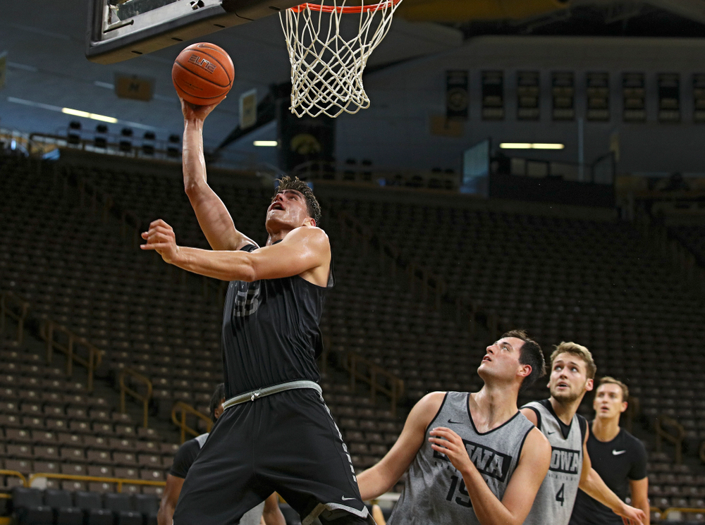 Iowa Hawkeyes center Luka Garza (55) puts up a shot during practice at Carver-Hawkeye Arena in Iowa City on Monday, Sep 30, 2019. (Stephen Mally/hawkeyesports.com)