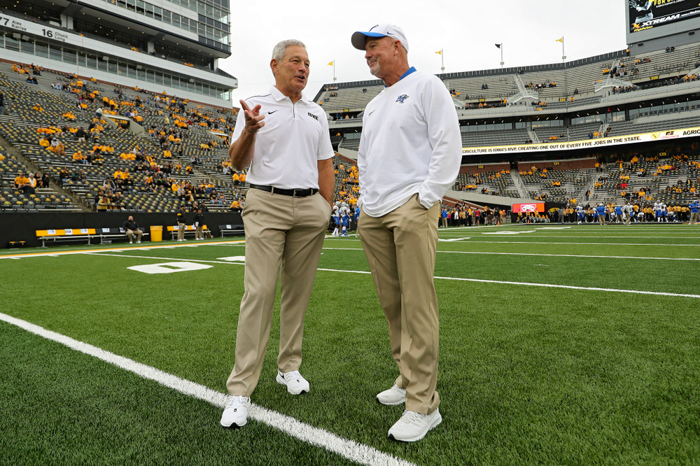 Iowa Hawkeyes head coach Kirk Ferentz (from left) talks with Middle Tennessee State head coach Rick Stockstill before their game at Kinnick Stadium in Iowa City on Saturday, Sep 28, 2019. (Stephen Mally/hawkeyesports.com)