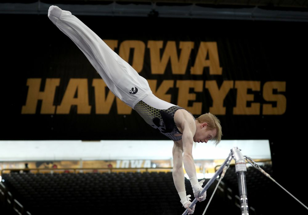 Iowa's Nick Merryman competes on the high bar against Illinois Sunday, March 1, 2020 at Carver-Hawkeye Arena. (Brian Ray/hawkeyesports.com)