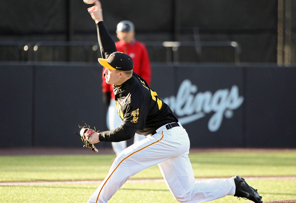 Iowa pitcher Hunter Lee (24) delivers to the plate during the first inning of their game at Duane Banks Field in Iowa City on Tuesday, March 3, 2020. (Stephen Mally/hawkeyesports.com)