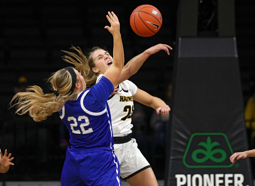 Iowa Hawkeyes guard Kathleen Doyle (22) blocks a shot by Drake Bulldogs guard Hannah Fuller (22) during the second quarter of their game at Carver-Hawkeye Arena in Iowa City on Saturday, December 21, 2019. (Stephen Mally/hawkeyesports.com)
