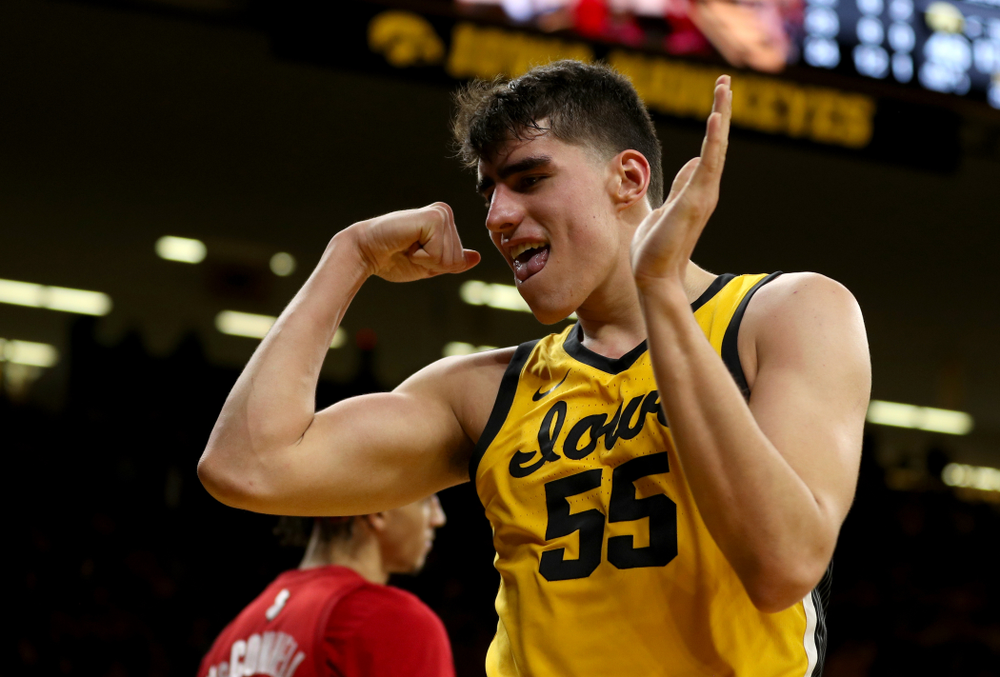 Iowa Hawkeyes forward Luka Garza (55) flexes after making a basket and drawing a foul against the Rutgers Scarlet Knights  Wednesday, January 22, 2020 at Carver-Hawkeye Arena. (Brian Ray/hawkeyesports.com)