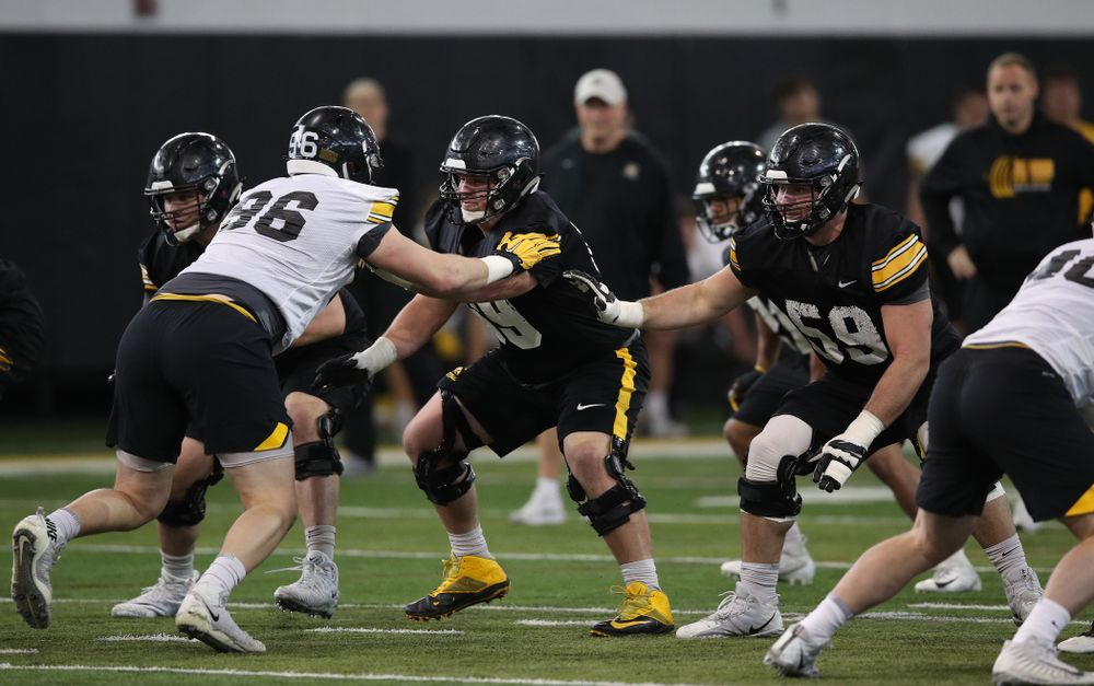 Iowa Hawkeyes offensive lineman Keegan Render (69) and offensive lineman Ross Reynolds (59) during preparation for the 2019 Outback Bowl Tuesday, December 18, 2018 at the Hansen Football Performance Center. (Brian Ray/hawkeyesports.com)