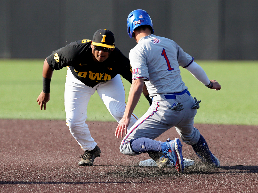 Iowa infielder Izaya Fullard (20) tags out a runner trying to steal second during the first inning of their college baseball game at Duane Banks Field in Iowa City on Tuesday, March 10, 2020. (Stephen Mally/hawkeyesports.com)