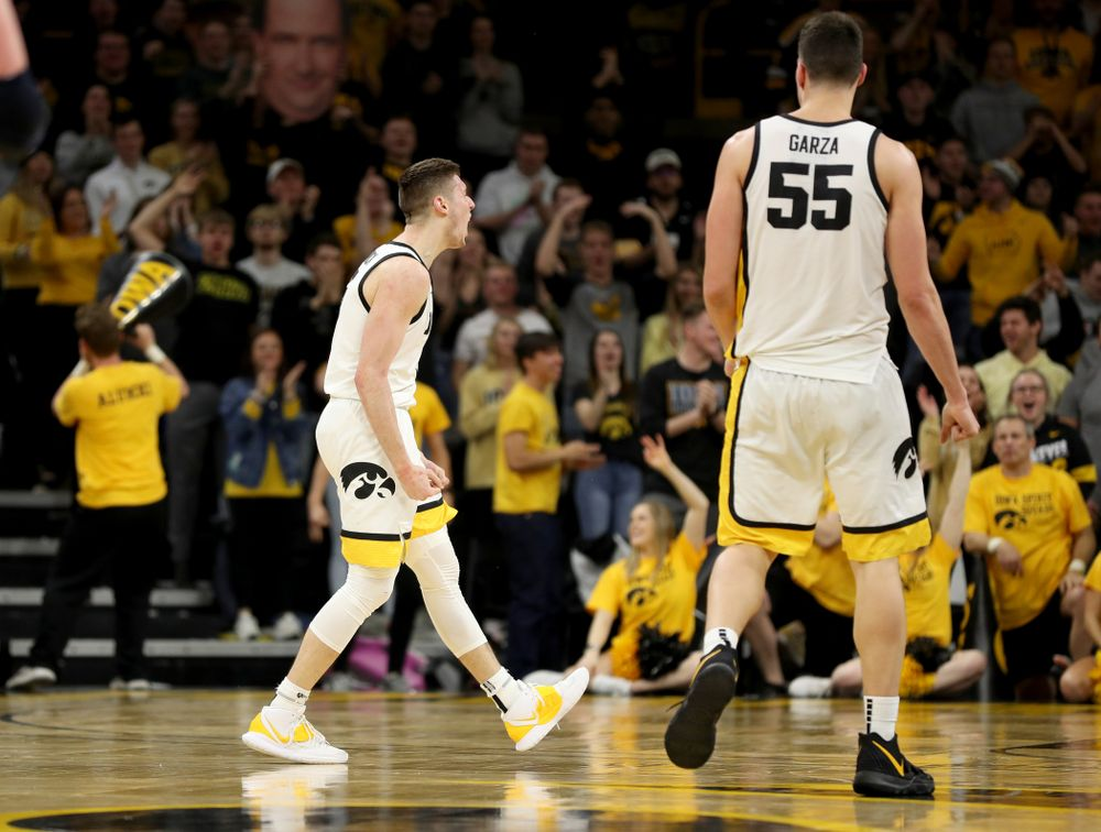 Iowa Hawkeyes guard CJ Fredrick (5) reacts after making a three point basket against the Michigan Wolverines Friday, January 17, 2020 at Carver-Hawkeye Arena. (Brian Ray/hawkeyesports.com)