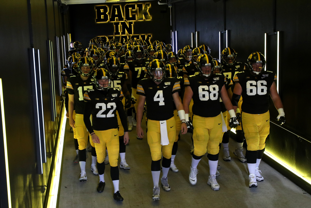 The Iowa Hawkeyes swarm to the field for their game against the Purdue Boilermakers Saturday, October 19, 2019 at Kinnick Stadium. (Brian Ray/hawkeyesports.com)