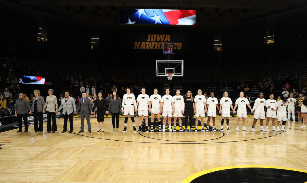 The Iowa Hawkeyes stand for the National Anthem before their game against the Wisconsin Badgers Monday, January 7, 2019 at Carver-Hawkeye Arena.  (Brian Ray/hawkeyesports.com)