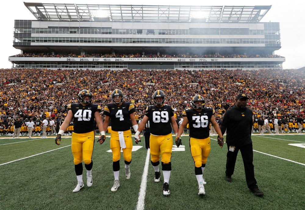 Iowa Hawkeyes captains defensive end Parker Hesse (40), quarterback Nate Stanley (4), offensive lineman Keegan Render (69), and fullback Brady Ross (36)against the Iowa State Cyclones Saturday, September 8, 2018 at Kinnick Stadium. (Brian Ray/hawkeyesports.com)