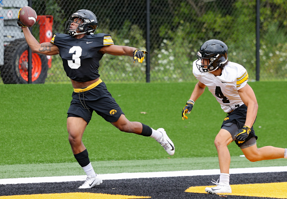 Iowa Hawkeyes wide receiver Tyrone Tracy Jr. (3) snags a pass as defensive back Dane Belton (4) closes in during Fall Camp Practice No. 15 at the Hansen Football Performance Center in Iowa City on Monday, Aug 19, 2019. (Stephen Mally/hawkeyesports.com)