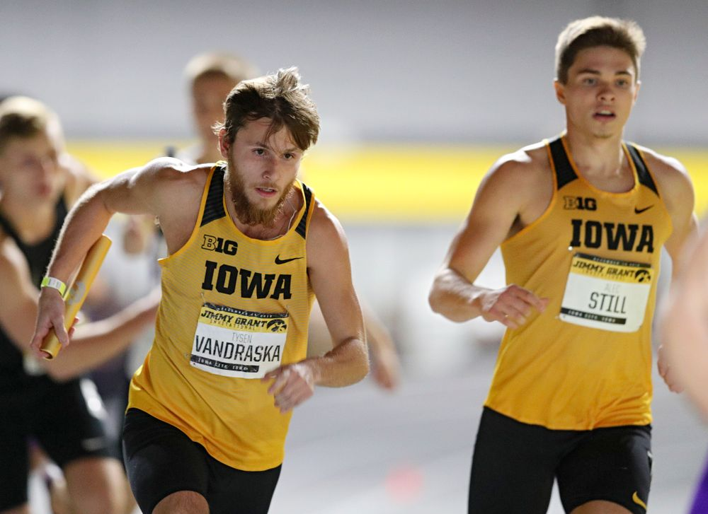 Iowa's Tysen VanDraska (from left) runs after taking the baton from Alec Still during the men's 1600 meter relay event during the Jimmy Grant Invitational at the Recreation Building in Iowa City on Saturday, December 14, 2019. (Stephen Mally/hawkeyesports.com)