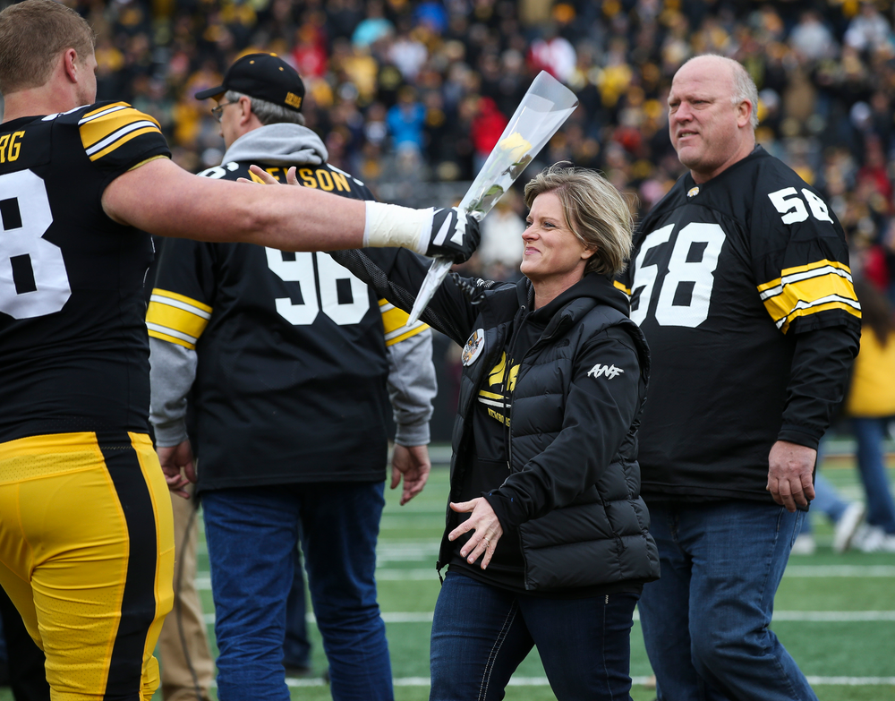 Iowa Hawkeyes offensive lineman Jake Newborg (58) is greeted by his parents during Senior Day ceremonies before a game against Nebraska at Kinnick Stadium on November 23, 2018. (Tork Mason/hawkeyesports.com)
