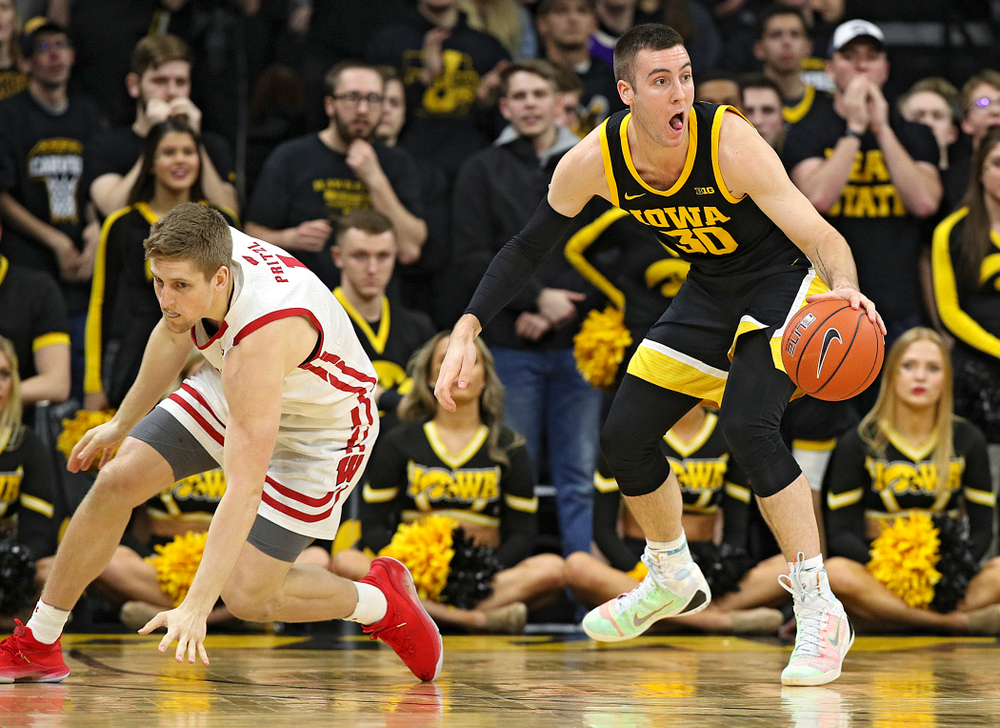 Iowa Hawkeyes guard Connor McCaffery (30) steals the ball away during the second half of their game at Carver-Hawkeye Arena in Iowa City on Monday, January 27, 2020. (Stephen Mally/hawkeyesports.com)