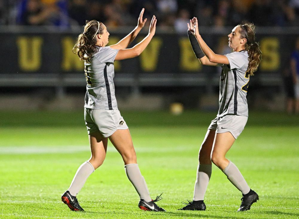 Iowa forward Kaleigh Haus (4) celebrates with midfielder Josie Durr (25) after scoring a goal during the second half of their match at the Iowa Soccer Complex in Iowa City on Friday, Sep 13, 2019. (Stephen Mally/hawkeyesports.com)