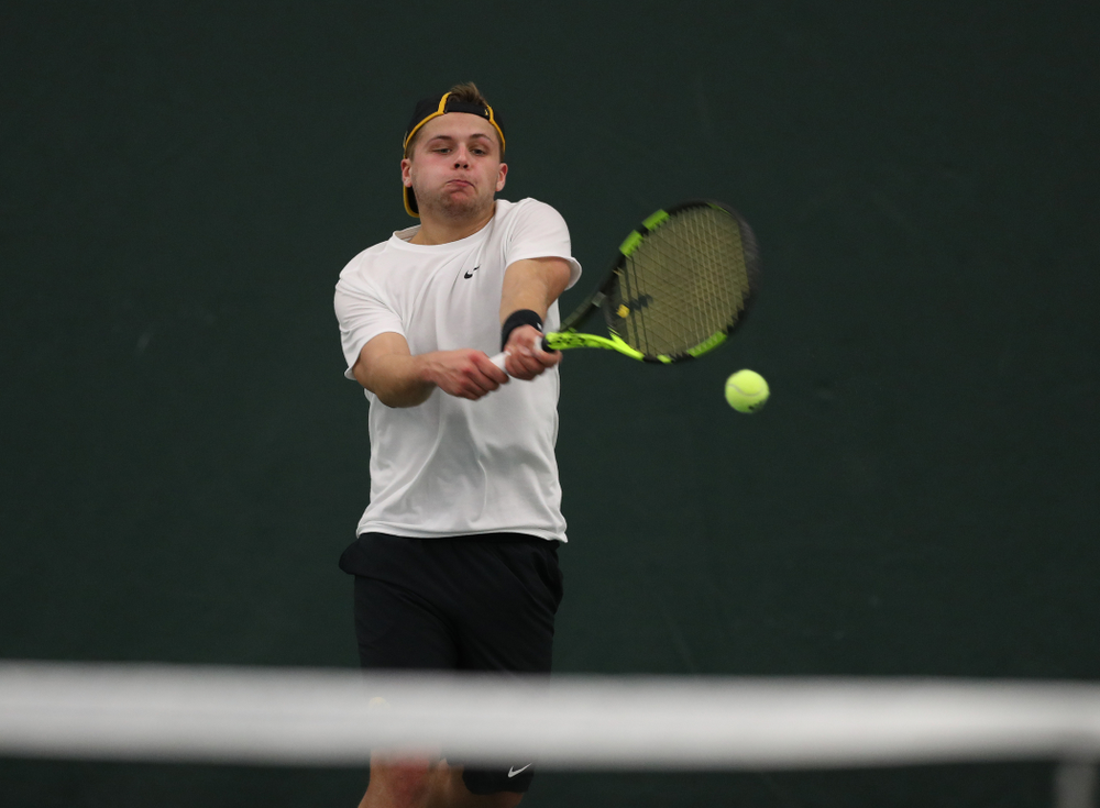 Will Davies against the Miami Hurricanes Friday, February 8, 2019 at the Hawkeye Tennis and Recreation Complex. (Brian Ray/hawkeyesports.com)