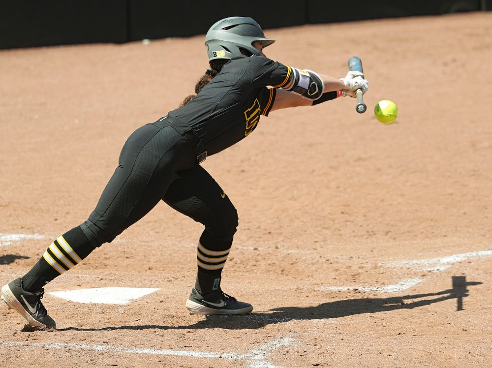 Iowa left fielder Lea Thompson (7) bunts and reached on a fielder's choice during the second inning of their game against Ohio State at Pearl Field in Iowa City on Saturday, May. 4, 2019. (Stephen Mally/hawkeyesports.com)