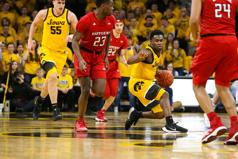 Iowa Hawkeyes guard Joe Toussaint (1) pivots around Rutgers guard Montez Mathis (23) during the Iowa men's basketball game vs Rutgers on Wednesday, January 22, 2020 at Carver-Hawkeye Arena. (Lily Smith/hawkeyesports.com)