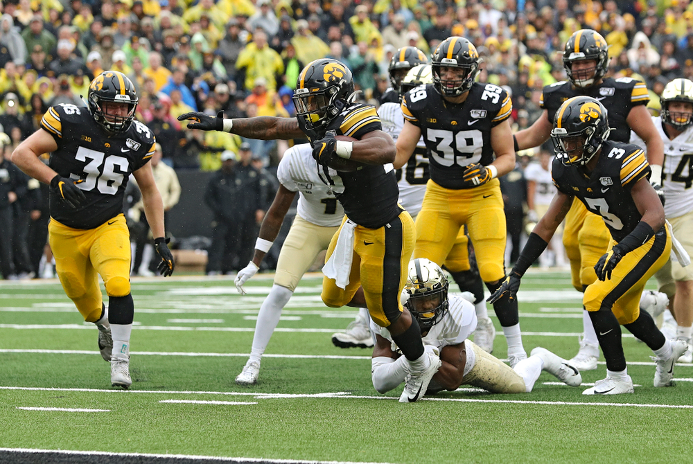 Iowa Hawkeyes running back Mekhi Sargent (10) pulls away from a defender on a touchdown run during the fourth quarter of their game at Kinnick Stadium in Iowa City on Saturday, Oct 19, 2019. (Stephen Mally/hawkeyesports.com)