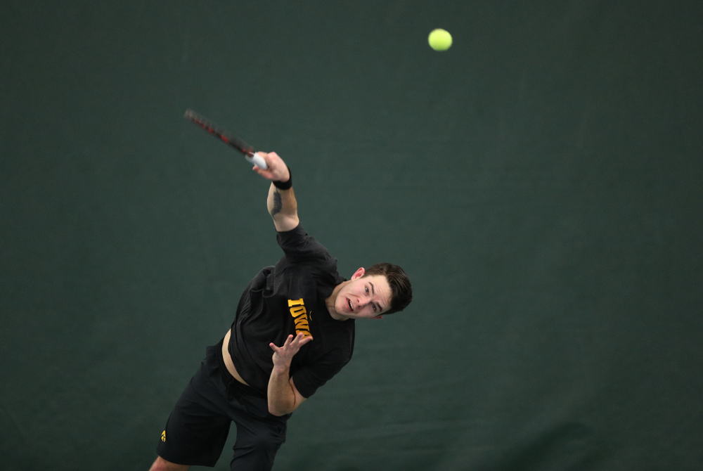 Jonas Larsen against the Miami Hurricanes Friday, February 8, 2019 at the Hawkeye Tennis and Recreation Complex. (Brian Ray/hawkeyesports.com)