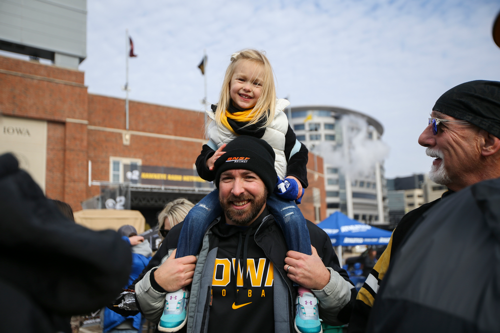 Iowa fans smile for a photo during Iowa football vs Minnesota on Saturday, November 16, 2019 at Kinnick Stadium. (Lily Smith/hawkeyesports.com)
