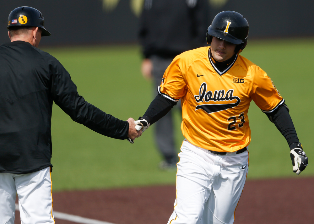 Iowa Hawkeyes infielder Kyle Crowl (23) rounds third base after hitting a home run during a game against Evansville at Duane Banks Field on March 18, 2018. (Tork Mason/hawkeyesports.com)