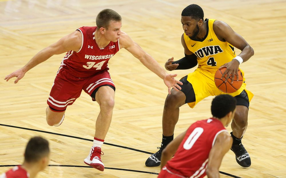 Iowa Hawkeyes guard Isaiah Moss (4) drives to the basket against Wisconsin on November 30, 2018 at Carver-Hawkeye Arena. (Tork Mason/hawkeyesports.com)