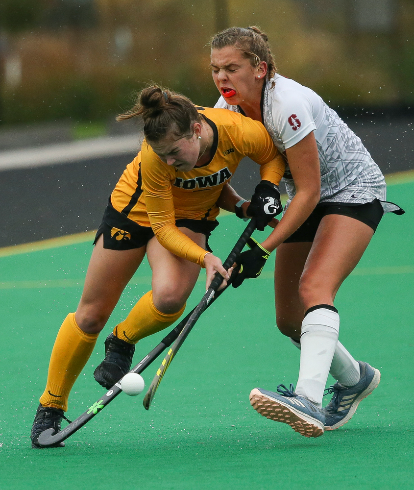 Iowa Hawkeyes midfielder Meghan Conroy (5) dribbles through contact during a game against Stanford at Grant Field on October 7, 2018. (Tork Mason/hawkeyesports.com)