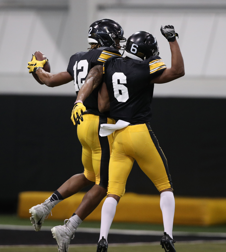 Iowa Hawkeyes wide receiver Brandon Smith (12) and wide receiver Ihmir Smith-Marsette (6) during preparation for the 2019 Outback Bowl Wednesday, December 19, 2018 at the Hansen Football Performance Center. (Brian Ray/hawkeyesports.com)