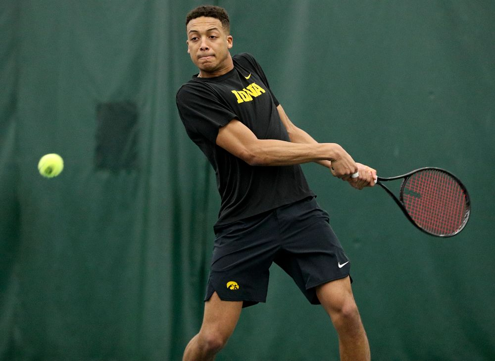 Iowa's Oliver Okonkwo lines up a shot during his doubles match at the Hawkeye Tennis and Recreation Complex in Iowa City on Friday, February 14, 2020. (Stephen Mally/hawkeyesports.com)