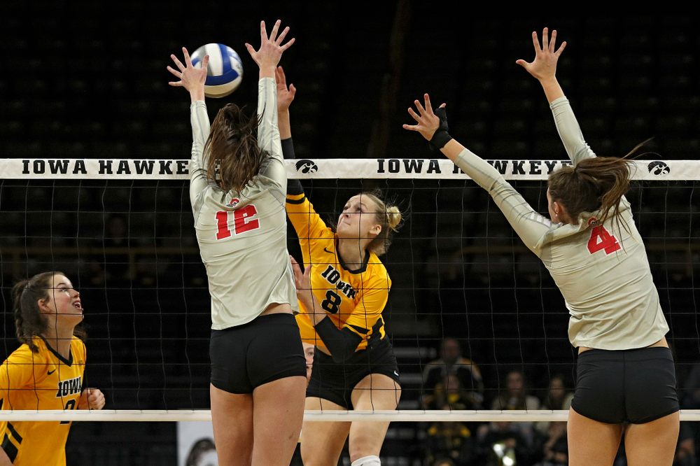 Iowa's Kyndra Hansen (8) lines up a kill shot during the first set of their match at Carver-Hawkeye Arena in Iowa City on Friday, Nov 29, 2019. (Stephen Mally/hawkeyesports.com)