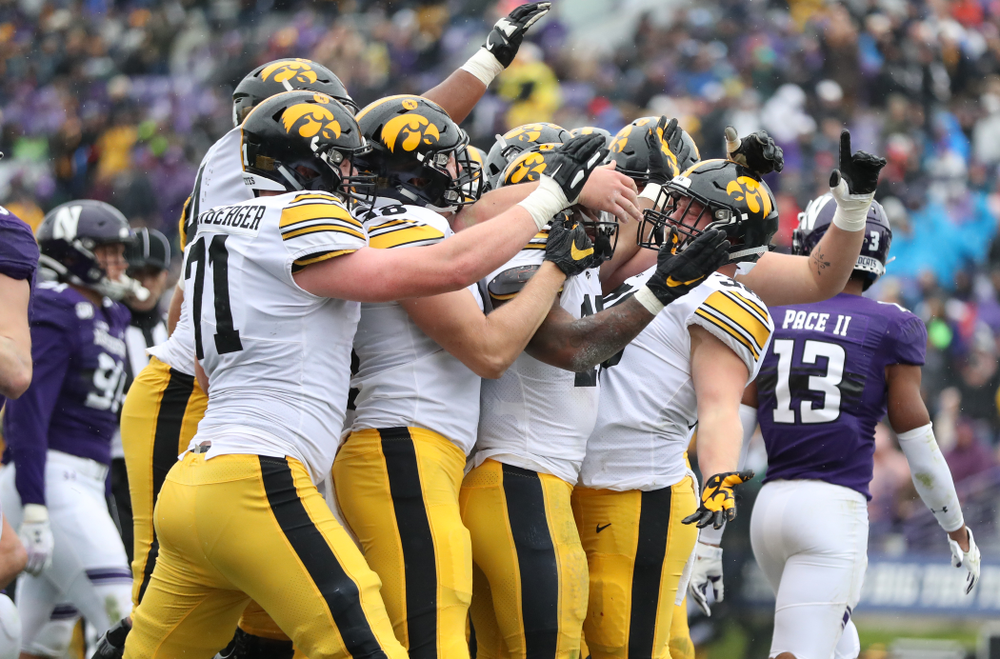 The Iowa Hawkeyes celebrate after scoring against the Northwestern Wildcats Saturday, September 28, 2019 at Kinnick Stadium. (Max Allen/hawkeyesports.com)