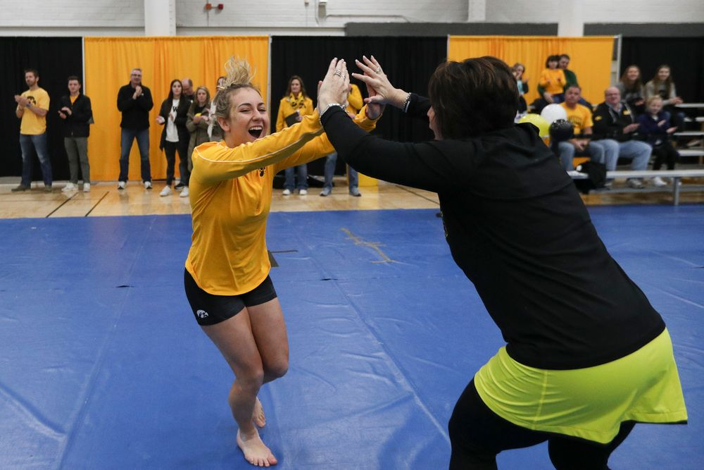 Alex Greenwald high fives assistant coach Jennifer Green during the Iowa women's gymnastics Black and Gold Intraquad Meet on Saturday, December 7, 2019 at the UI Field House. (Lily Smith/hawkeyesports.com)