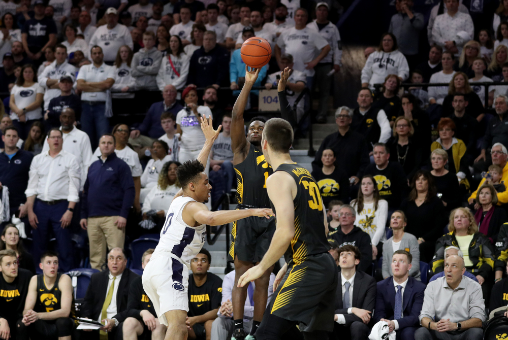 Iowa Hawkeyes guard Joe Toussaint (1) knocks down a three point basket against Penn State Saturday, January 4, 2020 at the Palestra in Philadelphia. (Brian Ray/hawkeyesports.com)