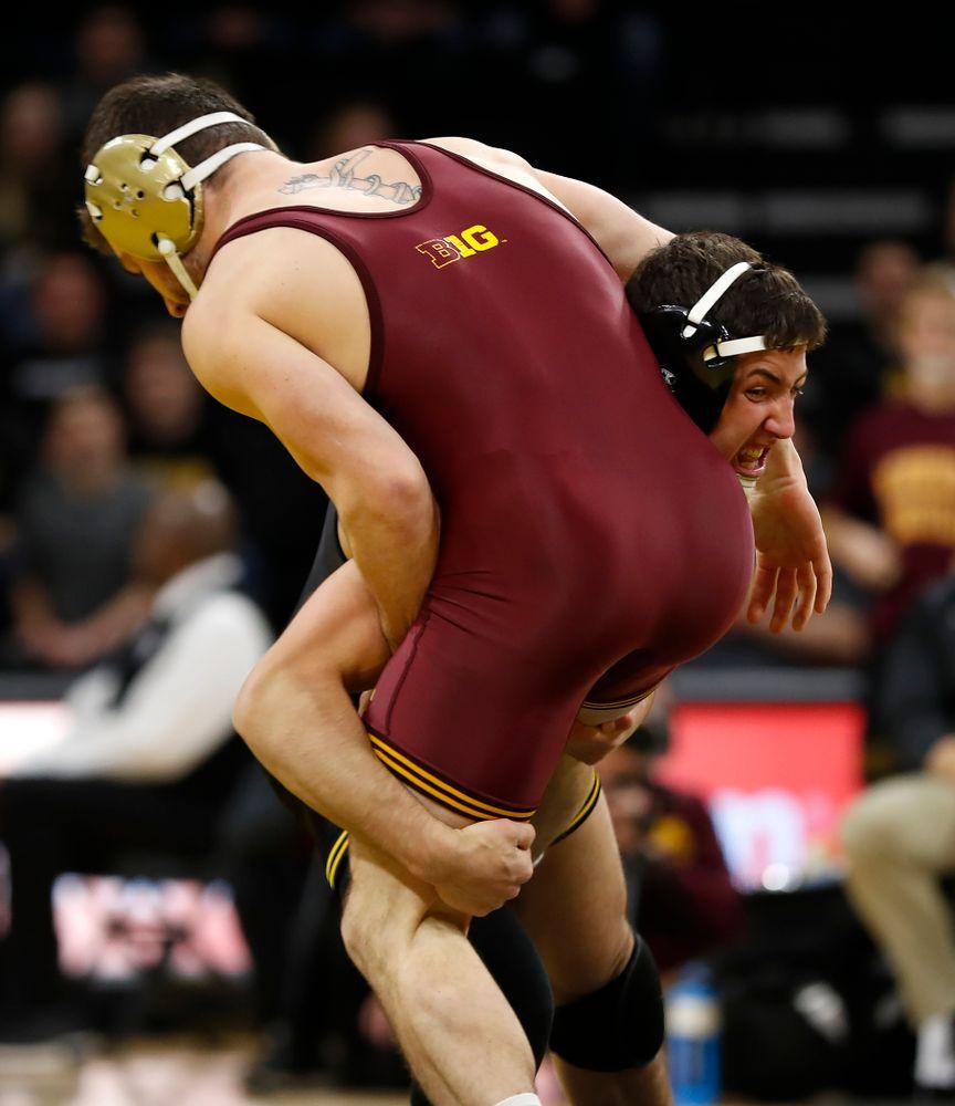 Iowa's Michael Kemerer wrestles Minnesota's Jake Short at 157 pounds