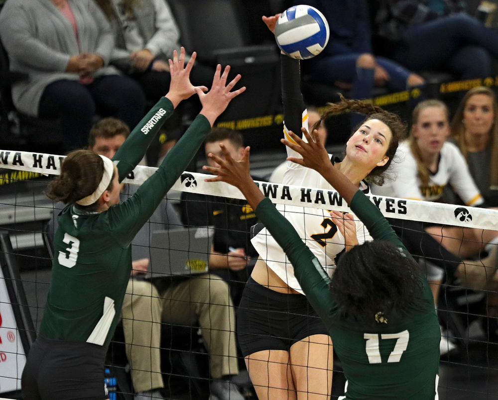 Iowa's Courtney Buzzerio (2) sends over a kill during the first set of their volleyball match at Carver-Hawkeye Arena in Iowa City on Sunday, Oct 13, 2019. (Stephen Mally/hawkeyesports.com)