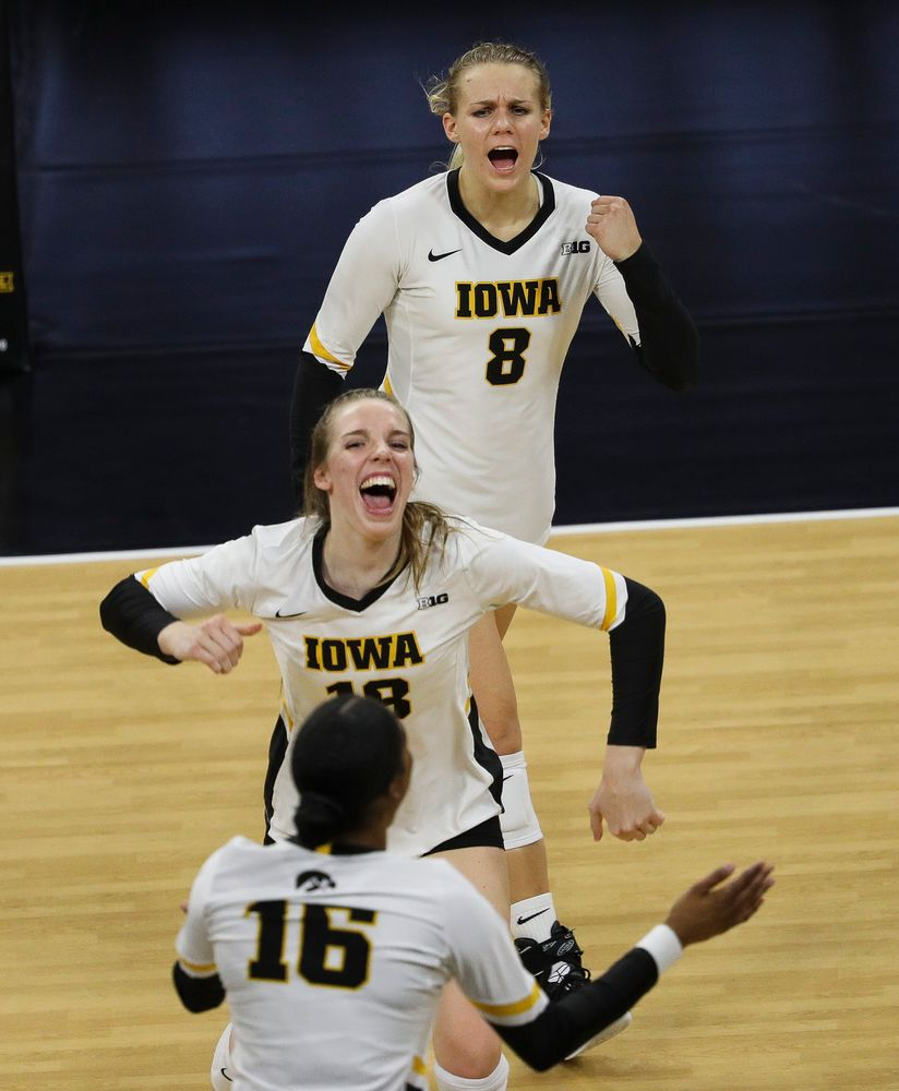 Iowa Hawkeyes right side hitter Reghan Coyle (8) and Iowa Hawkeyes middle blocker Hannah Clayton (18) celebrate after winning a point during a match against Rutgers at Carver-Hawkeye Arena on November 2, 2018. (Tork Mason/hawkeyesports.com)