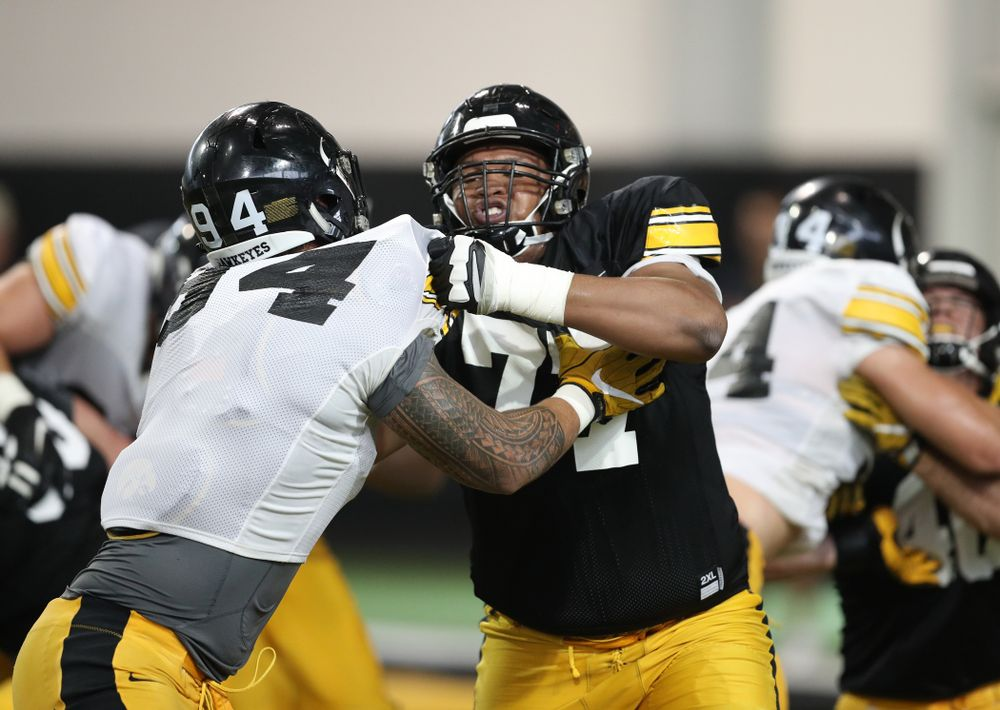 Iowa Hawkeyes defensive end A.J. Epenesa (94) and offensive lineman Alaric Jackson (77) uring Fall Camp Practice No. 6 Thursday, August 8, 2019 at the Ronald D. and Margaret L. Kenyon Football Practice Facility. (Brian Ray/hawkeyesports.com)